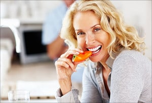 getty rf photo of woman eating a red bell pepper 300x203 5 Vital Foods for Anti Aging