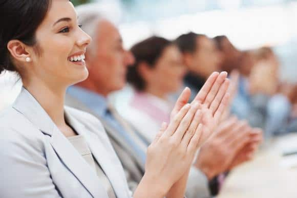 bigstock-Happy-Business-Woman-With-Coll-7014689