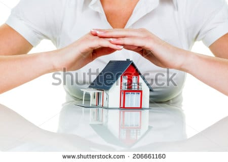 stock-photo-a-woman-protects-your-house-and-home-good-insurance-and-reputable-financing-calm-206661160